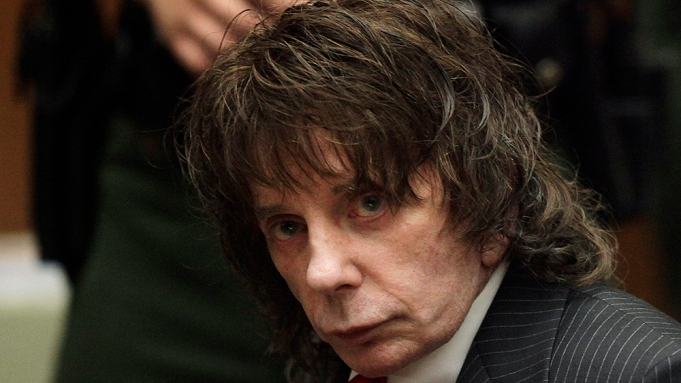 Music producer Phil Spector sits in