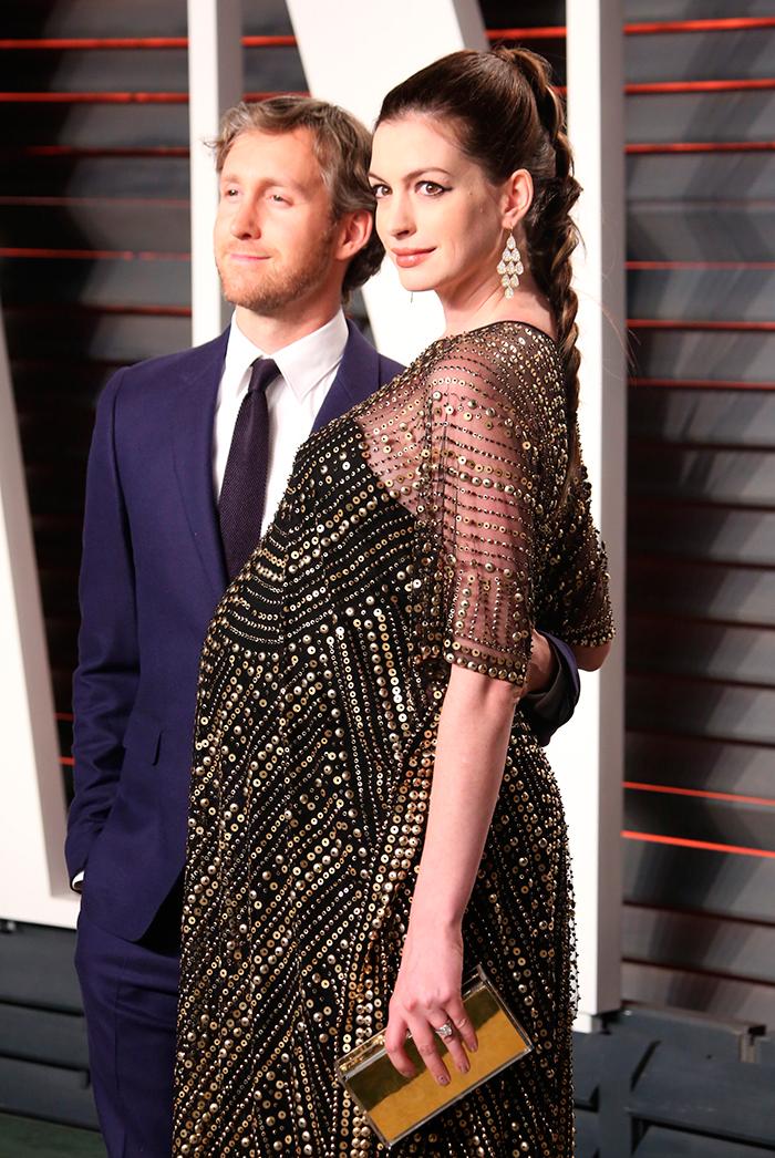 <p>Adam Shulman and Anne Hathaway at the Vanity Fair Oscar party.</p>