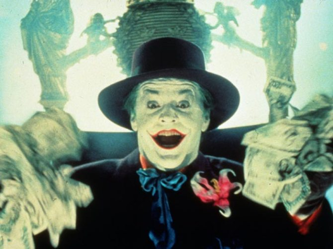 """It's not unusual to see a villain steal the show, but Nicholson didn't just steal Tim Burton's """"Batman."""" He stole it, danced on it, ate it for lunch, and came out the other side the way that only the Joker could: smiling! It's the one """"Batman"""" movie that could have been called, instead, """"The Joker,"""" and Nicholson, pushing the sarcastic lunacy he first perfected in """"The Shining"""" to the extreme breaking point, gave a performance that was pure, exuberant palm-buzzer vaudeville. In Burton's vision, Batman and the Joker have more in common than they once did — they're both creatures of the night, driven by the darkness of their obsessions. But it's Nicholson's Joker who's got the bats in his belfry."""