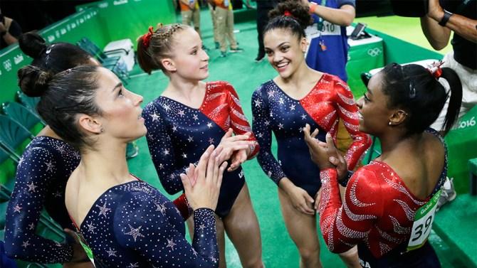 U.S. gymnasts, from left, Aly Raisman, Madison Kocian, Lauren Hernandez and Simone Biles wait for the score during the artistic gymnastics women's qualification at the 2016 Summer Olympics in Rio de Janeiro, Brazil, Sunday, Aug. 7, 2016. (AP Photo/Julio Cortez)