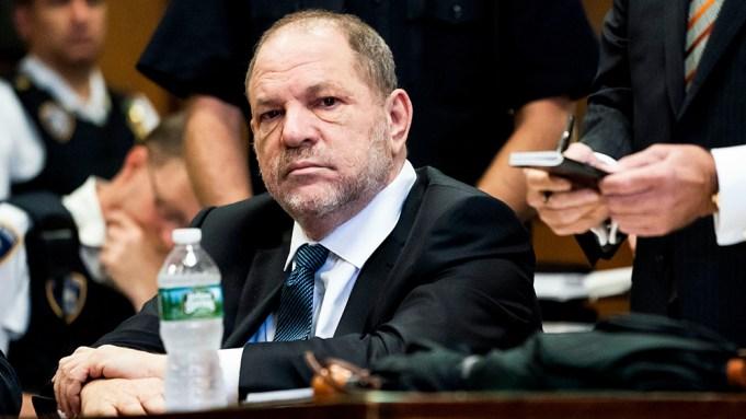 Former movie producer Harvey Weinstein (L)