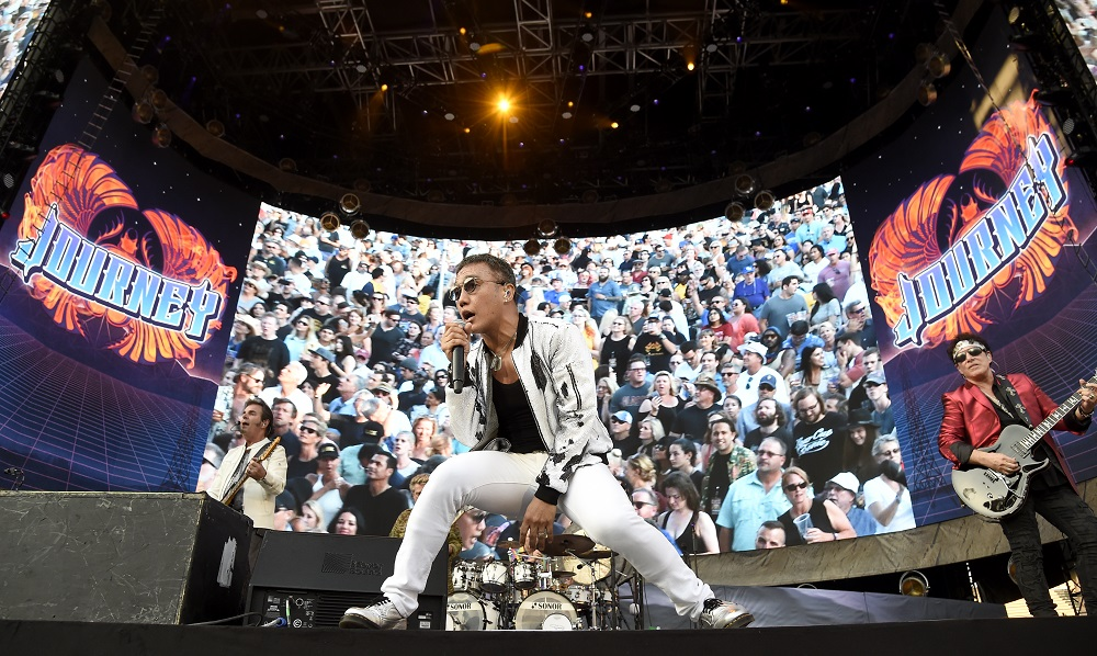 LOS ANGELES, CA - JULY 16: Arnel Pineda and Neal Schon of Journey performs onstage during The Classic West at Dodger Stadium on July 16, 2017 in Los Angeles, California. (Photo by Kevin Mazur/Getty Images for Scoop Marketing)
