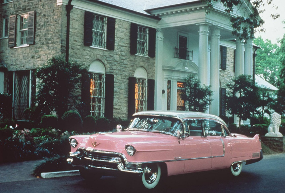 Editorial Use Only. Consent Required for Commercial Use and Book Publications Mandatory Credit: Photo by News Ltd/Newspix/REX/Shutterstock (846105a) Elvis Presley's Graceland home with a 1955 Cadillac motor vehicles. Graceland, home of singer Elvis Presley in Memphis, America - 1970s