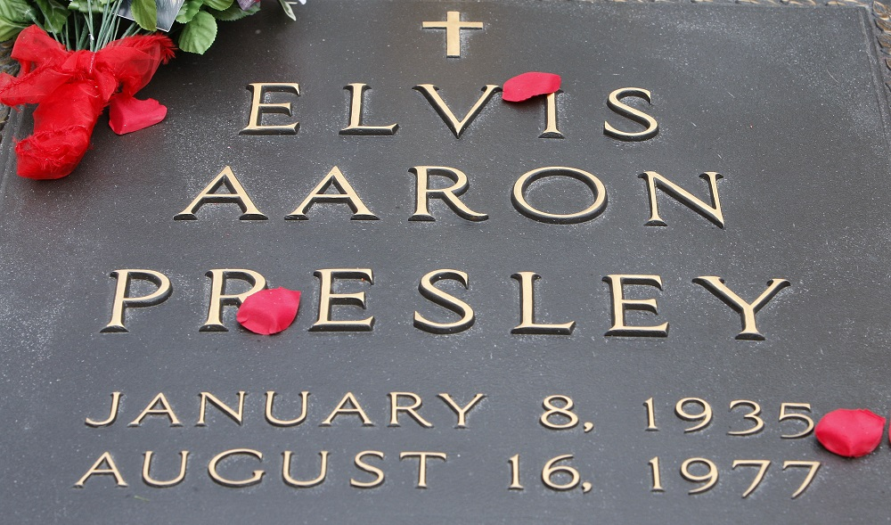 Flowers are shown on the grave of Elvis Presley at Graceland, Presley's home in Memphis, Tenn.,, Presley's 75th birthday Elvis At 75, Memphis, USA