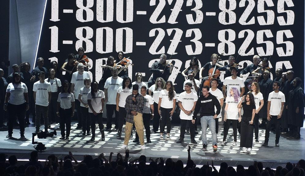 "Logic, Alessia Cara, Khalid Khalid, from left, Logic, and Alessia Cara perform ""1-800-272-8255"" at the MTV Video Music Awards."