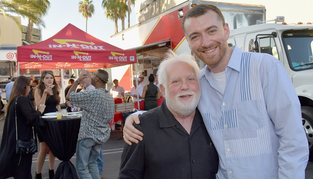 Noted television producer Ken Ehrlich (L) and recording artist Sam Smith attend Capitol Music Group's Capitol Congress party in Hollywood.