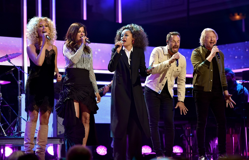 NASHVILLE, TN - OCTOBER 18: (L-R) Singer-songwriter Kimberly Schlapman and Karen Fairchild of Little Big Town, Andra Day, Jimi Westbrook and Philip Sweet of Little Big Town perform onstage at the 2017 CMT Artists Of The Year on October 18, 2017 in Nashville, Tennessee. (Photo by John Shearer/Getty Images for CMT)
