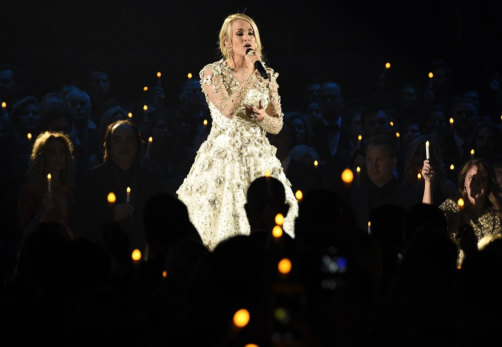 """Carrie Underwood performs """"Softly and Tenderly"""" during an In Memoriam tribute at the 51st annual CMA Awards at the Bridgestone Arena, in Nashville, Tenn51st Annual CMA Awards - Show, Nashville, USA - 08 Nov 2017"""