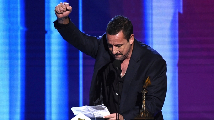 Adam Sandler accepts the award for