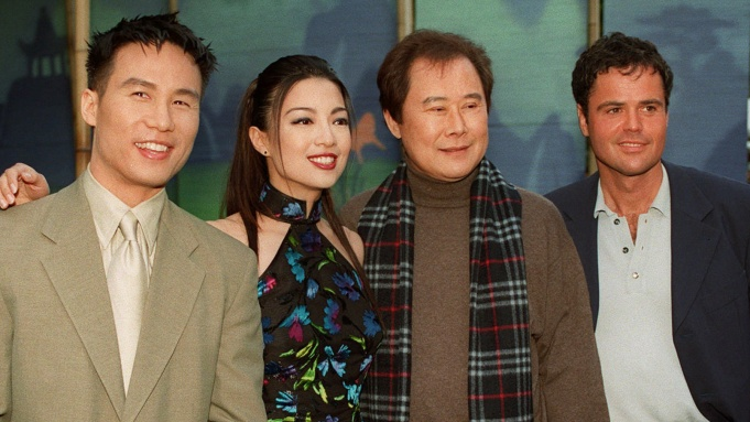 """Star """"voices"""" of Walt Disney Picture's 36th full-length animated feature, """"Mulan,"""" pose, left to right, B.D. Wong, the acting voice of Shang; Ming-Na Wen, the acting voice of Mulan; Soon-Tek Oh, the acting voice of Fa Zhou and Donny Osmond, the singing voice of Shang, at the film's premiere Friday June 5, 1998 in Los Angeles. The film is based on one of China's most popular legends in which a woman disguises herself as a man to protect her father and save her country. (AP Photo/Reed Saxon)"""