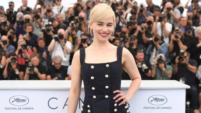Actress Emilia Clarke poses for photographers