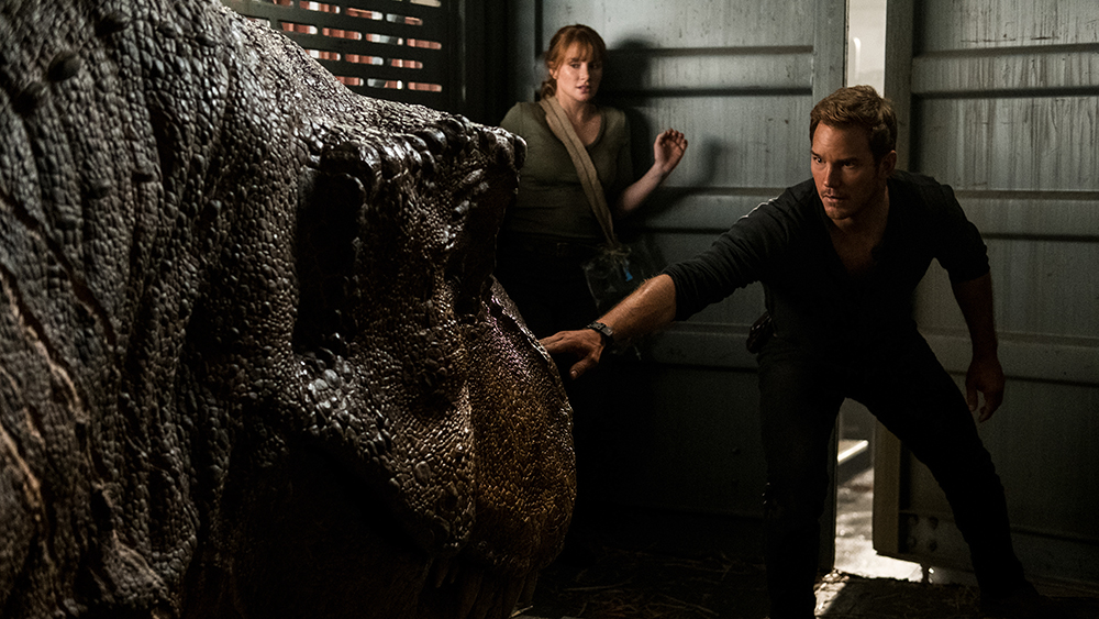"""Claire (BRYCE DALLAS HOWARD) and Owen (CHRIS PRATT) try not to wake the mighty T. rex in """"Jurassic World: Fallen Kingdom."""" When the island's dormant volcano begins roaring to life, Owen and Claire mount a campaign to rescue the remaining dinosaurs from this extinction-level event. Welcome to """"Jurassic World: Fallen Kingdom."""""""