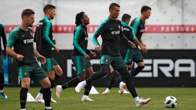 Portugal's Cristiano Ronaldo, right, plays the