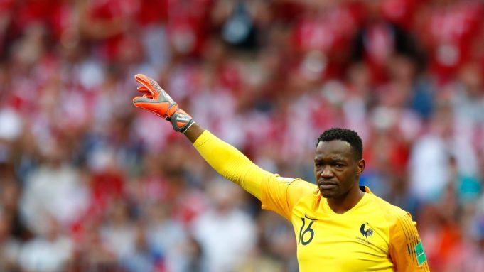 France goalkeeper Steve Mandanda gestures to