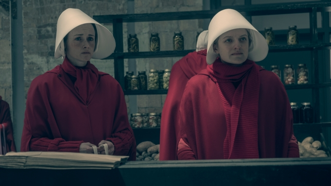 """The Handmaid's Tale  --""""After"""" - Episode 207 -- An incident sends shockwaves through both Gilead and Little America. Serena Joy makes a dangerous choice in order to protect her family. Moira searches for someone from her past.Ê Ofglen (Alexis Bledel) and Offred (Elisabeth Moss), shown. (Photo by: George Kraychyk/Hulu)"""