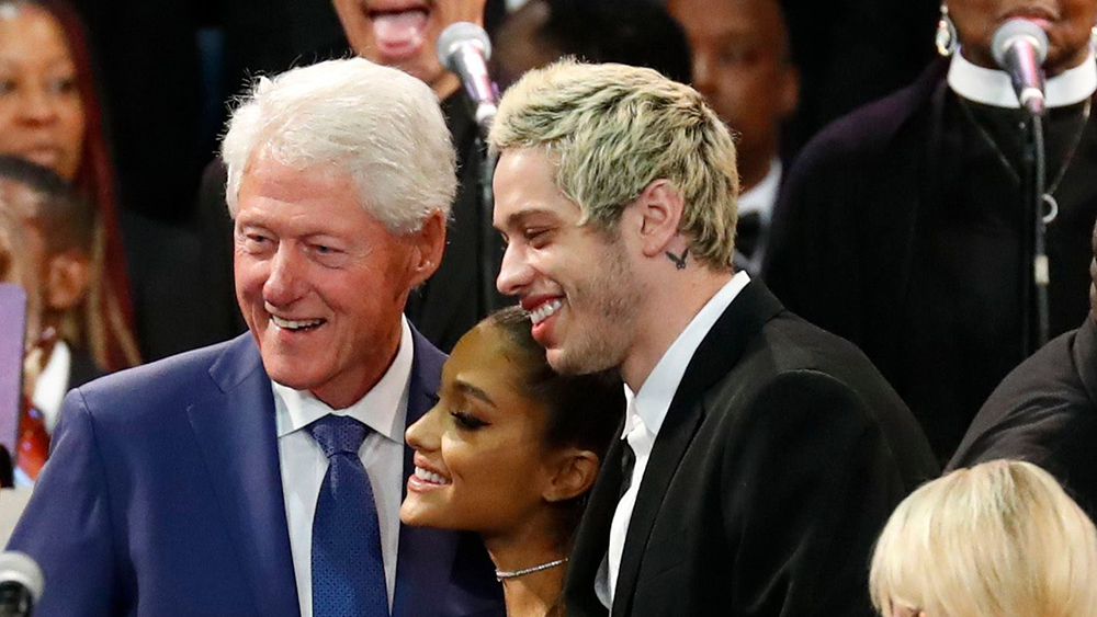 Former President Bill Clinton poses for a photo with Ariana Grande, center, and Pete Davidson, right, during the funeral service for Aretha Franklin at Greater Grace Temple, in Detroit. Franklin died Aug. 16, 2018 of pancreatic cancer at the age of 76Aretha Franklin, Detroit, USA - 31 Aug 2018