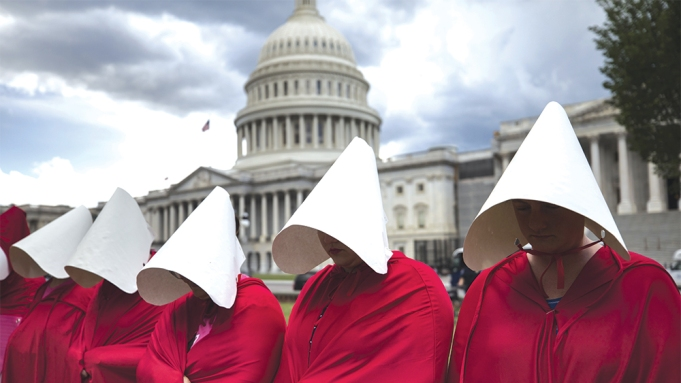 Supporters of Planned Parenthood dress in