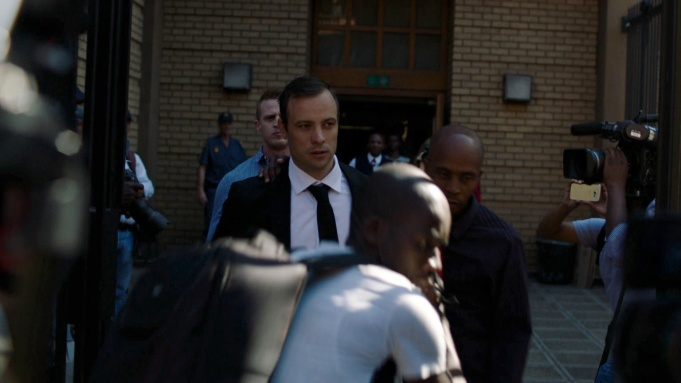 Oscar Pistorius emerges from court