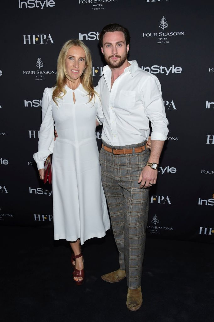 Sam Taylor-Johnson, Aaron Taylor-Johnson. Actor Aaron Taylor-Johnson, right, and wife Sam Taylor-Johnson attend the Hollywood Foreign Press Association/Instyle party on Day 3 of the Toronto International Film Festival at the Four Seasons Hotel Toronto, in Toronto 2018 TIFF - HFPA/Instyle Party, Toronto, Canada - 08 Sep 2018