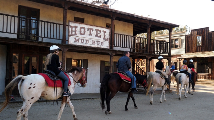 A group of tourists ride horses