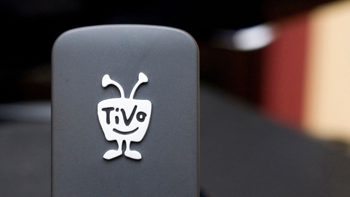 Taken March 1, 2010, a TiVo Wireless N Adapter is displayed in New York. Digital TV listing company Rovi is buying TiVo in a cash-and-stock deal valued at about $1.1 billion. Rovi Corp. said that it will pay $10.70 in cash and stock for each TiVo Inc. share. Rovi will pay $2.75 per share in cash, or about $277 million. The rest, $7.95 per share, will be paid in stockRovi-TiVo, New York, USA