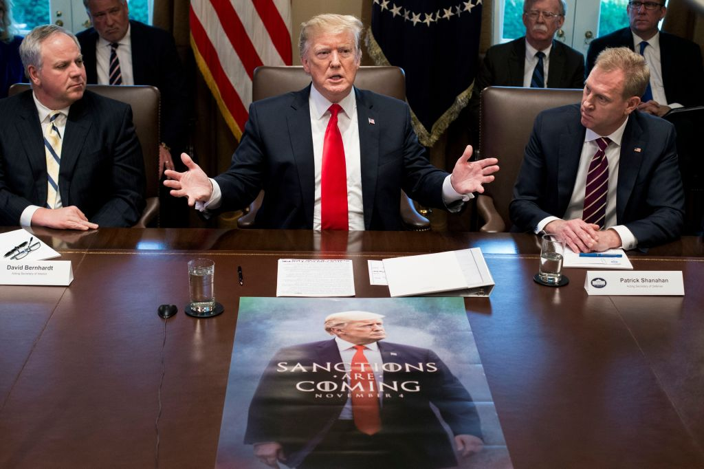 US President Donald J. Trump (C) speaks in front of a poster depicting his image, beside US Acting Secretary of the Interior David Bernhardt (L) and Acting Secretary of Defense Patrick Shanahan (R); during a meeting with members of Trump's Cabinet in the Cabinet Room of the White House in Washington, DC, USA, 02 January 2019. President Trump used the opportunity to speak on plans to host Congressional Democratic and Republican leaders to discuss the ongoing partial shutdown of the federal government and funding for border security. Trump also spoke on international affairs and the economy. US President Donald J. Trump holds a Cabinet meeting, Washington, USA - 02 Jan 2019