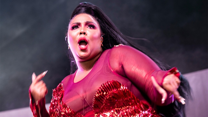 Lizzo performs on stage during the