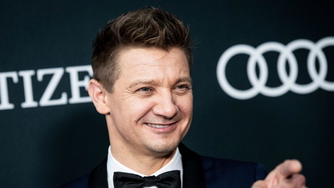 Jeremy Renner poses for the photographers