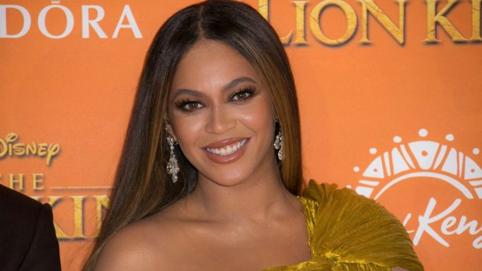 Beyonce poses for photographers upon arrival