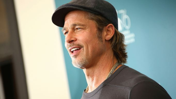 Brad Pitt poses for photographers at