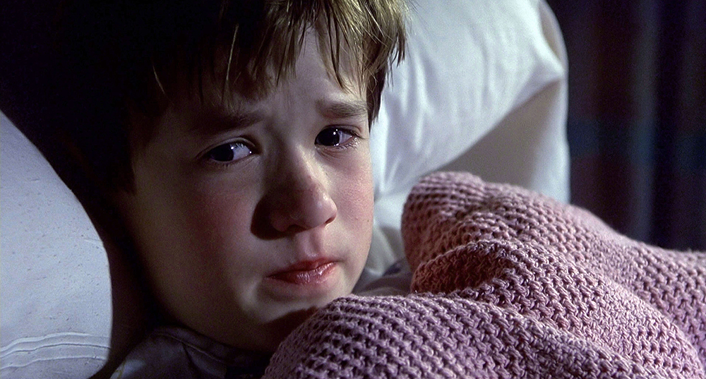 Editorial use only. No book cover usage. Mandatory Credit: Photo by Moviestore/Shutterstock (1635849b) The Sixth Sense (1999) Haley Joel Osment The Sixth Sense - 1999