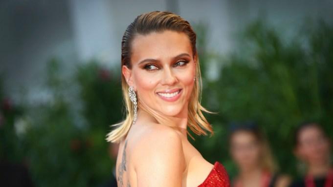 Scarlett Johansson poses for photographers upon