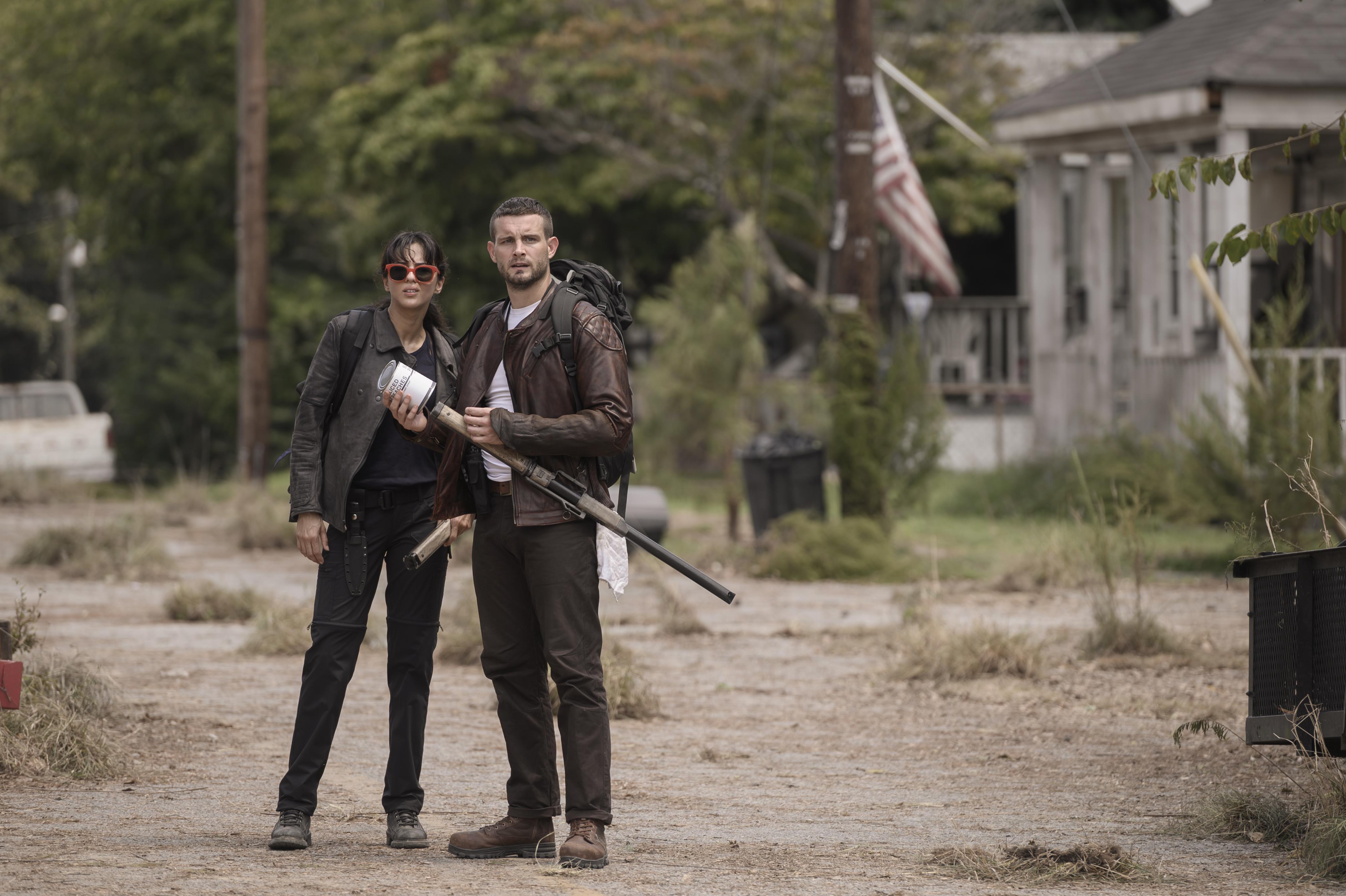 Nico Tortorella as Felix, Annet Mahendru as Huck - TWD3 _ Season 1 - Photo Credit: Jojo Whilden/AMC