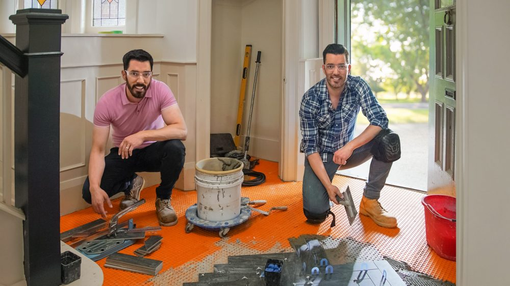 Drew and Jonathan during tile installation on Amy and Kate's home, as seen on Property Brothers: Forever Home.