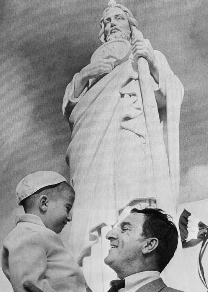 Comedian Danny Thomas happily greeted an unidentified fan after unveiling the statue of St. Jude at dedication ceremonies for the new five million dollar hospital on in Memphis. 25 years earlier Thomas prayed to St. Jude, the Patron Saint of hopeless causes, asking success and promised a shrine in return. The hospital will specialize in research in children's diseasesDanny Thomas, Memphis, USA