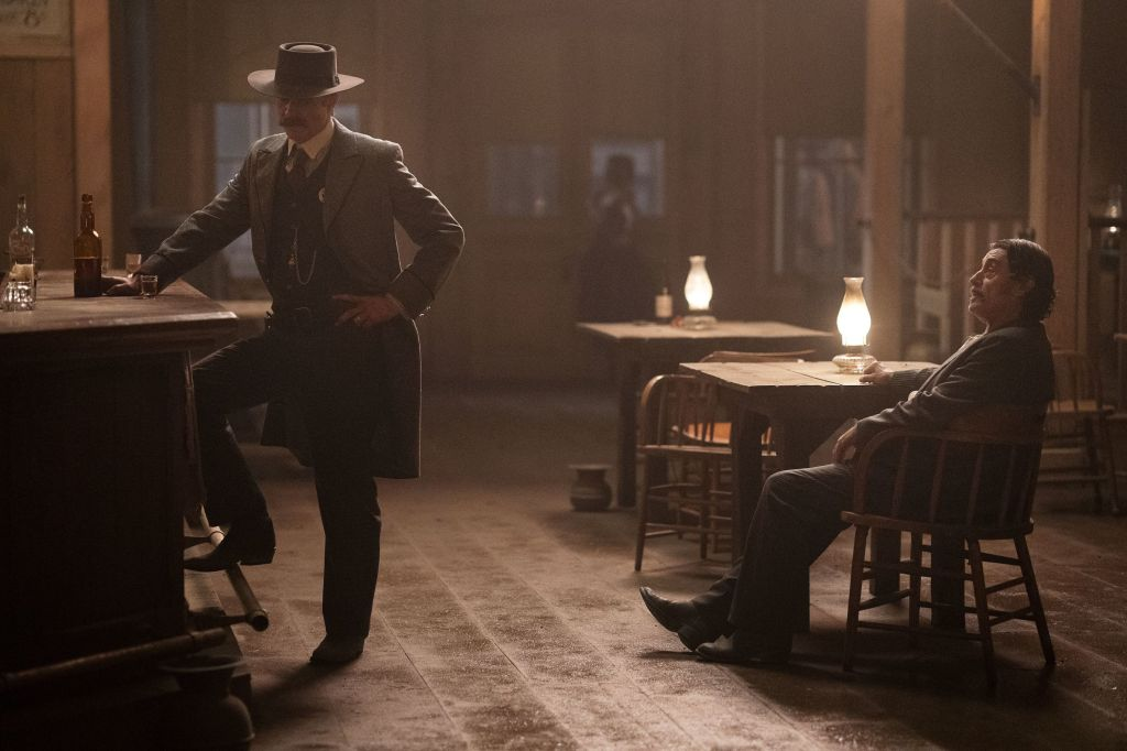 Editorial use only. No book cover usage.Mandatory Credit: Photo by HBO/Kobal/Shutterstock (10330323s) Timothy Olyphant as Seth Bullock and Ian McShane as Al Swearengen 'Deadwood: The Movie' Film - 2019 As the residents of Deadwood gather to commemorate Dakota's statehood in 1889, saloon owner Al Swearengen and Marshal Seth Bullock clash with Senator George Hearst.
