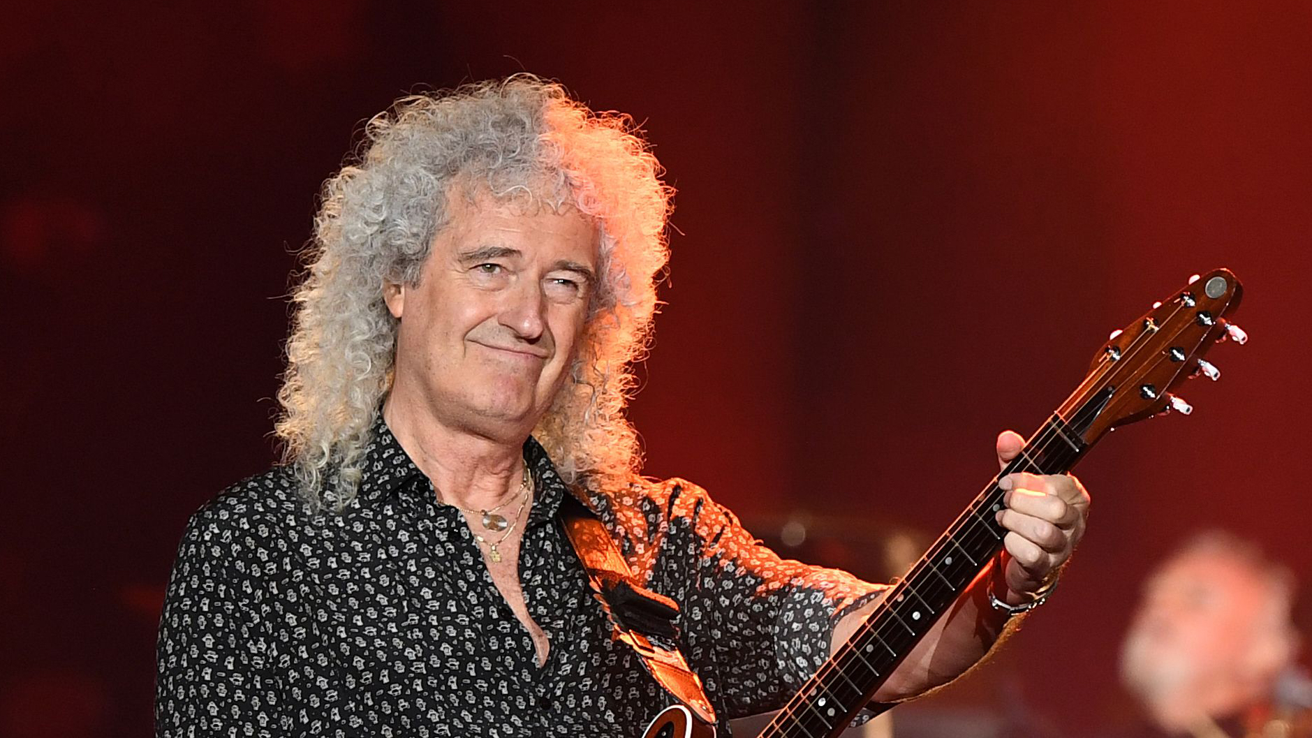 Queen's Brian May Hospitalized After Ripping Glutes While Gardening -  Variety