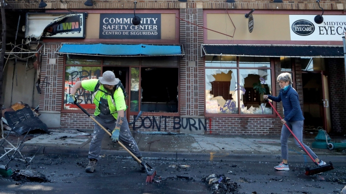 People help cleanup near businesses damaged