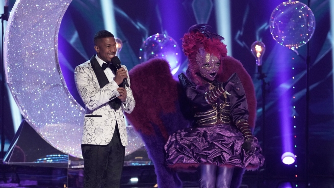 """THE MASKED SINGER: Host Nick Canon and Night Angel in the """"A Day In the Mask: The Semi Finals / After the Mask: A Day In the Mask: The Semi Finals"""" special two-hour episode of THE MASKED SINGER airing Wednesday, May 13 (8:00-10:00 PM ET/PT) on FOX. CR: Michael Becker / FOX."""