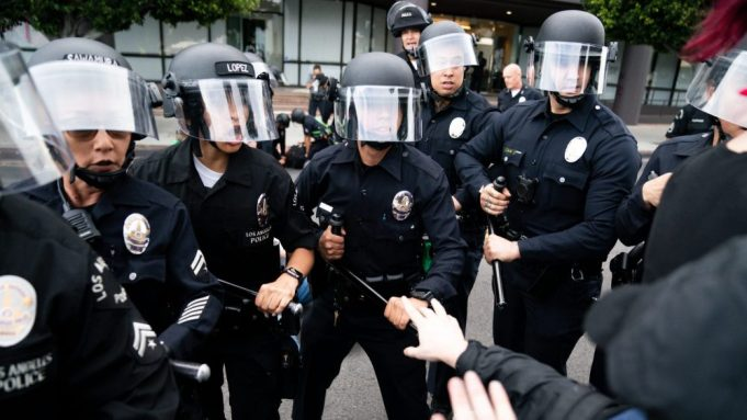 Law enforcement push forward moving protesters