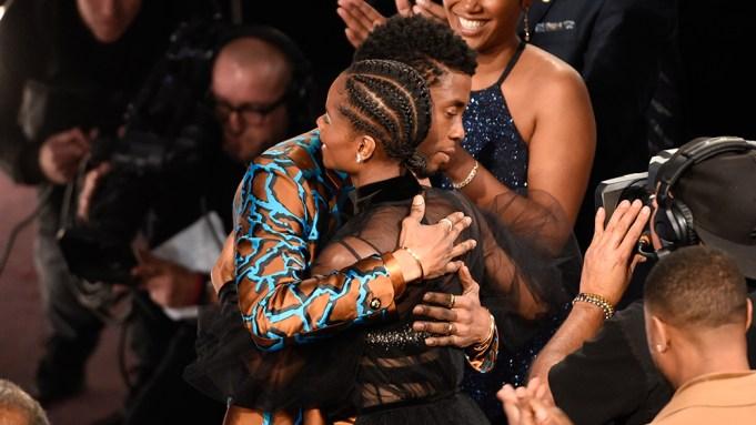 Chadwick Boseman, left, congratulates Letitia Wright