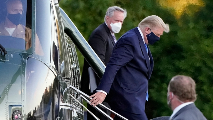 President Donald Trump arrives at Walter Reed National Military Medical Center, in Bethesda, Md., Friday, Oct. 2, 2020, on Marine One helicopter after he tested positive for COVID-19. White House chief of staff Mark Meadows is at second from left. (AP Photo/Jacquelyn Martin)