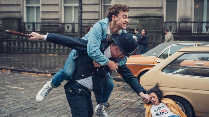 Richie (Olly Alexander) ontop of policeman.Person
