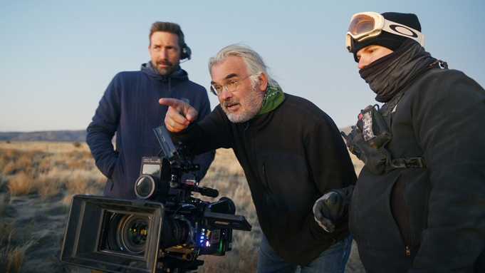 NEWS OF THE WORLD, director Paul Greengrass (center) with crew members, on set, 2020. ph: Bruce Talamon / © Universal Pictures / Courtesy Everett Collection