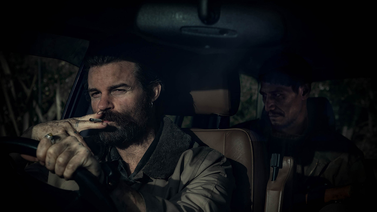 Daniel Gillies and Matthias Luafutu appear in Coming Home in the Dark by James Ashcroft, an official selection of the Midnight section at the 2021 Sundance Film Festival. Courtesy of Sundance Institute   photo by Goldfish Creative.All photos are copyrighted and may be used by press only for the purpose of news or editorial coverage of Sundance Institute programs. Photos must be accompanied by a credit to the photographer and/or 'Courtesy of Sundance Institute.' Unauthorized use, alteration, reproduction or sale of logos and/or photos is strictly prohibited.