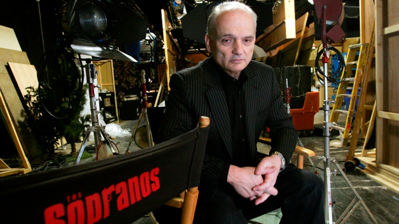 "FILE - In this March 3, 2006 file photo, David Chase, creator and producer of the hit HBO series ""The Sopranos,"" poses on a set in the Queens borough of New York. Warner Bros. Pictures says Thursday that New Line has purchased a screenplay for a ""Sopranos"" prequel from series creator David Chase and Lawrence Konner. The studio says the working title is ""The Many Saints of Newark"" and will be set in the 1960s during the Newark riots. Chase's acclaimed series about the mobster Tony Soprano played by the late James Gandolfini ran for six seasons on HBO and won 21 primetime Emmys. (AP Photo/Diane Bondareff, File)"