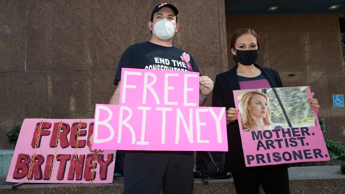 Dusten Strand and Niki Norberto of Phoenix, Arizona attends a Free Britney Protests at the Stanley Mosk Courthouse in Los Angeles, California on February 10, 2021