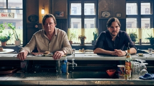 Daniel Bruhl on Using Words as Weapons in Directorial Debut Black Comedy 'Next Door'