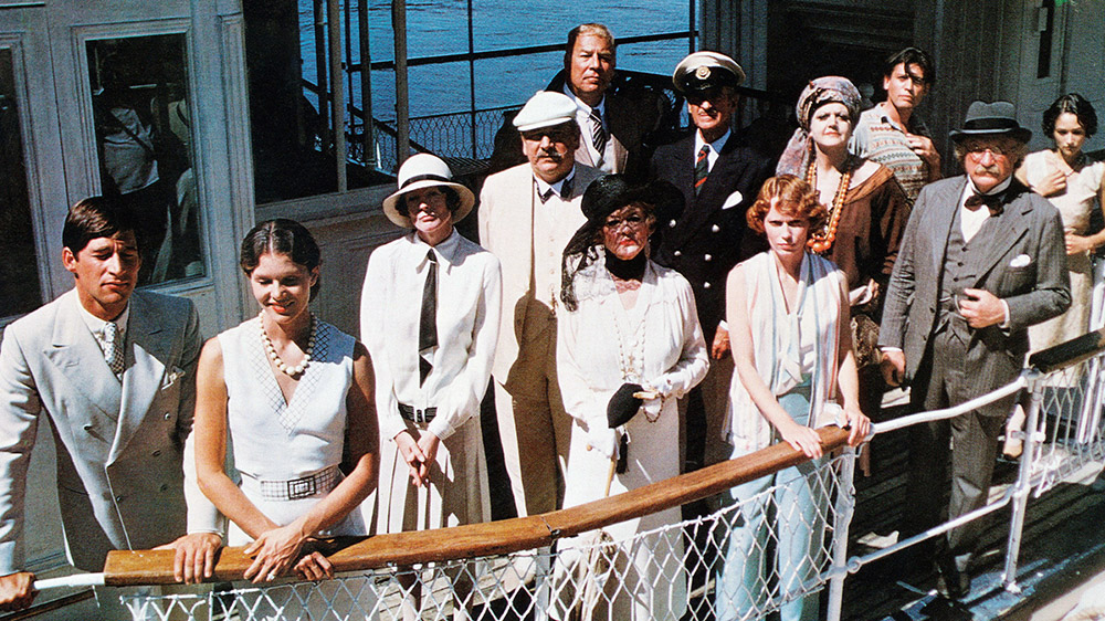 DEATH ON THE NILE, front from left: Simon MacCorkindale, Lois Chiles, first row from left: Maggie Smith, Peter Ustinov (cap), Bette Davis, Mia Farrow, second row from left: George Kennedy, David Niven, Angela Lansbury, Jack Warden, rear from left: Jon Finch, Olivia Hussey, 1978, © Paramount/courtesy Everett Collection