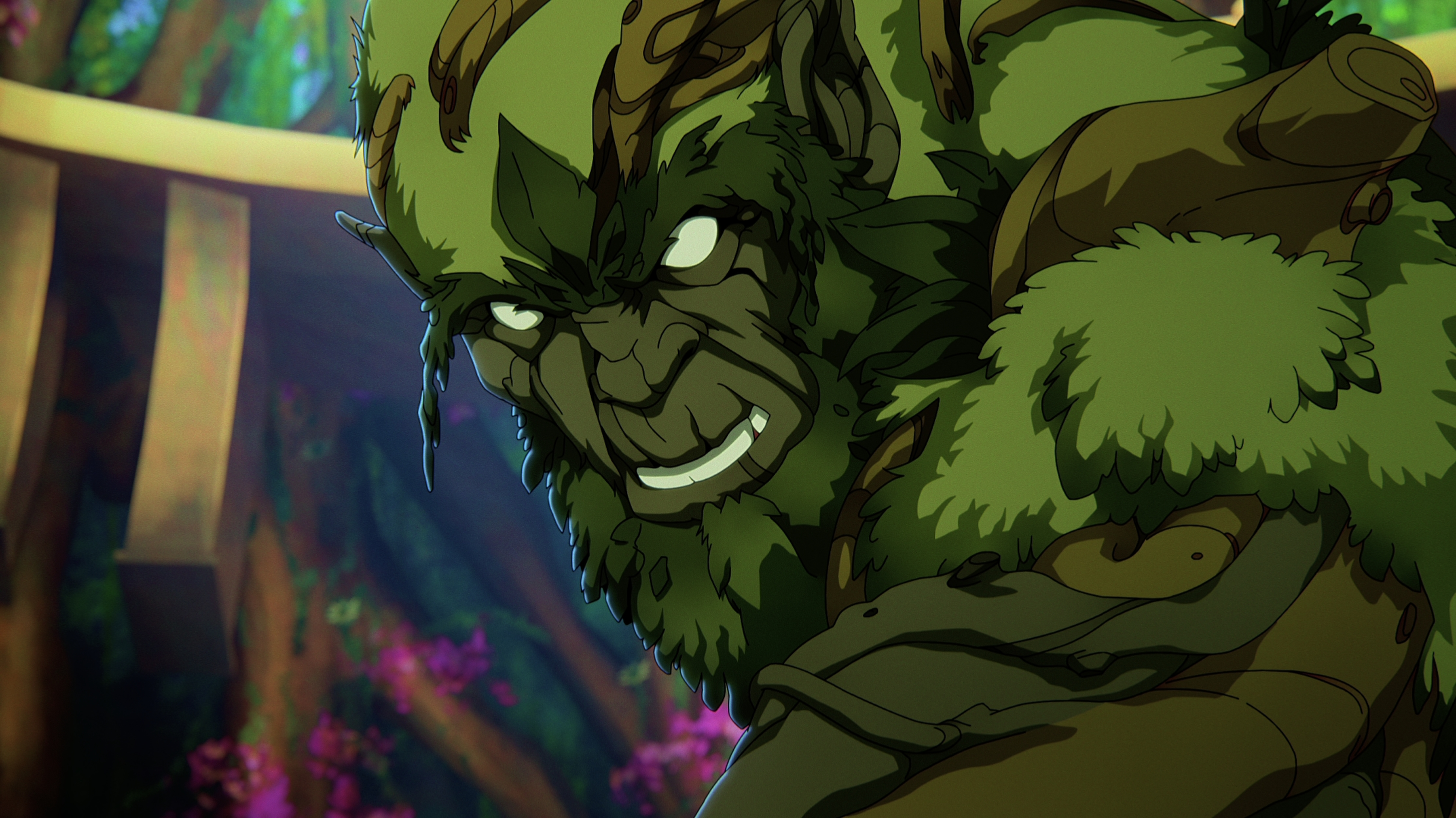 In a CG animated still from Masters of the Universe: Revelation, Moss Man leans down and is surrounded by bright foliage of the forest. He is made up of moss, grass, vines and branches in various shades of green.